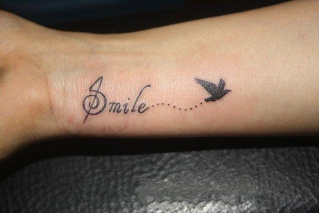 hình xăm chữ smile cùng con chim nhỏ đẹp